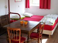 Bed en eettafel in het Hokling